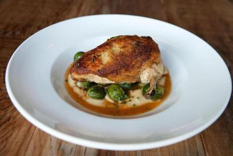 Roasted free-range chicken, parsnip puree, thyme braised brussels sprouts, and natural jus.